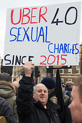 Whitehall, London, February 10th 2016. A taxi driver's banner points out the dangers of using unlicenced cabs as an estimated 8,000 cabbies hold a go-slow in protest against what they say is unfair competition from minicab and Uber drivers who do not have to undergo the rigorous training and checks required for the licenced taxi trade. ///FOR LICENCING CONTACT: paul@pauldaveycreative.co.uk TEL:+44 (0) 7966 016 296 or +44 (0) 20 8969 6875. ©2015 Paul R Davey. All rights reserved.