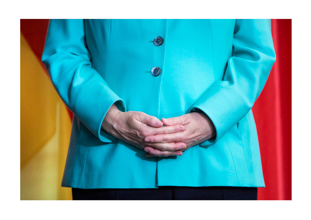 German Chancellor Angela Merkel  wait as German and Chinese counterparts sign and exchange mutual agreement,  prior to a Joint press conference in the Chancellery in Berlin, on July 5 2017.<br /> (Photo by Omer Messinger)