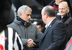 Manchester United manager Jose Mourinho (left) and Newcastle United manager Rafael Benitez shake hands before the match begins during the Premier League match at St James' Park, Newcastle.