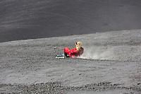 People tourists surf boarding the  Cerro Negro Volcano in Nicaragua