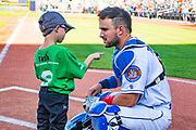 Amarillo Sod Poodles catcher Luis Torrens (21) with a Junior Soddie before the game against the Springfield Cardinals on Wednesday, July 17, 2019, at HODGETOWN in Amarillo, Texas. [Photo by John Moore/Amarillo Sod Poodles]