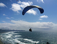 Paragliders and hang gliders launch from the the top of Maxwell Mt. Rad in Oceanside, Oregon.