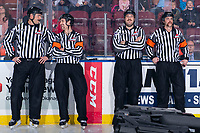 KELOWNA, BC - NOVEMBER 30: Ice officials Mike Roberts, Kevin Bennett, Nathan Vanoosten and Steve Papp stand at the timekeepers box at the Kelowna Rockets against the Prince George Cougars at Prospera Place on November 30, 2019 in Kelowna, Canada. (Photo by Marissa Baecker/Shoot the Breeze)