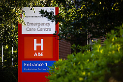 """© Licensed to London News Pictures . 10/08/2021. Wigan , UK . GV of Royal Albert Edward Infirmary A&E in Wigan . Yesterday and today (9th and 10th August 2021) the hospital has published advice for people to stay away unless facing an emergency , as officials describe services as being """"very busy"""" . Photo credit : Joel Goodman/LNP"""
