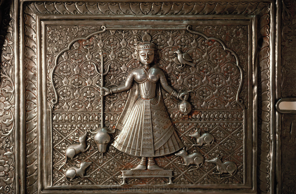 Silver door with image of Karni Mata and rats at the Hindu Rat Temple in Deshnoke, Rajasthan, India. This ornate Hindu temple was constructed by Maharaja Ganga Singh in the early 1900s as a tribute to the rat goddess, Karni Mata..