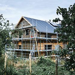 A wooden house being built in the village. Saint-Pierre-de-Frugie, France. July 12, 2019.<br /> Une maison en bois en cours de construction. Saint-Pierre-de-Frugie, France. 12 juillet 2019.