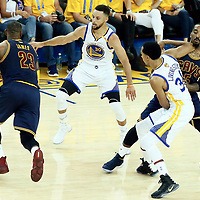 01 June 2017: Cleveland Cavaliers forward LeBron James (23) drives past Golden State Warriors guard Shaun Livingston (34) on a screen set by Cleveland Cavaliers guard JR Smith (5) and faces Golden State Warriors guard Stephen Curry (30) during the Golden State Warriors 113-90 victory over the Cleveland Cavaliers, in game 1 of the 2017 NBA Finals, at the Oracle Arena, Oakland, California, USA.