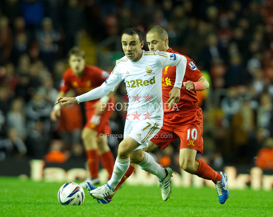 LIVERPOOL, ENGLAND - Wednesday, October 31, 2012: Swansea City's Leon Britton in action against Liverpool's Joe Cole during the Football League Cup 4th Round match at Anfield. (Pic by David Rawcliffe/Propaganda)
