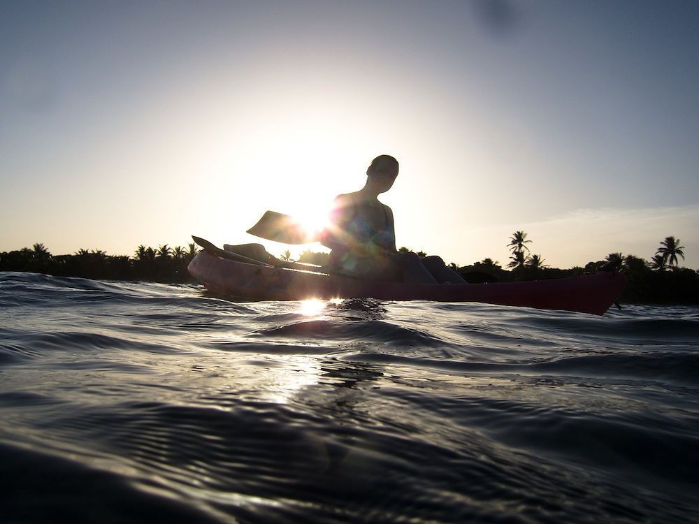 Ambergris Caye, Belize 8/31/2012.Sara kayaking at sunset at Tranquility Bay..Alex Jones / www.alexjonesphoto.com