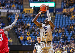 Dec 1, 2018; Morgantown, WV, USA; West Virginia Mountaineers forward Lamont West (15) shoots during the second half against the Youngstown State Penguins at WVU Coliseum. Mandatory Credit: Ben Queen-USA TODAY Sports