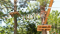 Gunstock Mountain Resort's Treetop Adventure Rope Course offers a challenge for Jim Bobotas of Gilford as he makes his way through the final black course on July 4th.  (Karen Bobotas/for the Laconia Daily Sun)