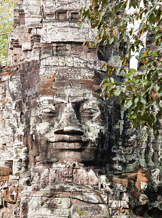 A stone face built into the wall at the Bayon temple in Angkor, Siem Reap Province, Cambodia