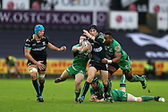Sam Davies of the Ospreys ©  breaks past Naulia Dawai ® and  Caolin Blade (l) of Connacht. Guinness Pro12 rugby match, Ospreys v Connacht rugby at the Liberty Stadium in Swansea, South Wales on Saturday 7th January 2017.<br /> pic by Andrew Orchard, Andrew Orchard sports photography.