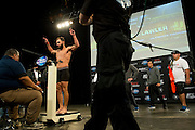 Johny Hendricks weighs in for the second time at Gilley's in Dallas, Texas on March 14, 2014. After weighing in 1.5 lbs over the first time, officials gave Johny two hours to cut the remaining weight or he would not be allowed to fight for the title during UFC 171 the following day.