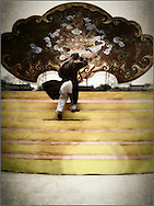 A person climbs on a stage in Hue, Vietnam, Southeast Asia