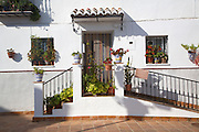 Potted plants outside home in the<br /> Andalusian village of Comares, Malaga province, Spain