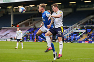 Oxford United defender Sam Long (12) gets ahead of Peterborough Utd Midfielder Reece Brown (12) during the EFL Sky Bet League 1 match between Peterborough United and Oxford United at London Road, Peterborough, England on 17 October 2020.