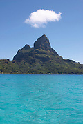 Mount Otemanu with cloud, Bora Bora, Society Islands, photographed  from across the lagoon