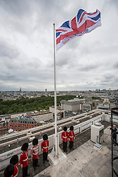 © licensed to London News Pictures. London, UK 21/06/2013. Armed Forces flag being raised on the roof of City Hall, Westminster, to mark the beginning of Armed Forces Week. The ceremony is attended by members of the Scots and Coldstream Guards and the Lord Mayor of Westminster on Photo credit: Tolga Akmen/LNP