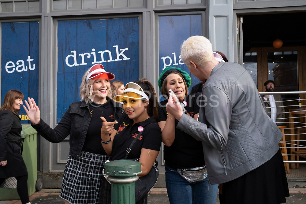 Hen do and a 50th birthday party collide while out on Broad Street on 14th March 2020 in Birmingham, United Kingdom. A bachelorette party, hen party, hen night or hen do, is a party held for a women about to get married.