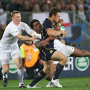 Nick De Luca, Scotland, is tackled by Manu Tuilagi, England, during the England V Scotland Pool B match during the IRB Rugby World Cup tournament. Eden Park, Auckland, New Zealand, 1st October 2011. Photo Tim Clayton...