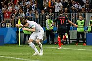 Mario Mandzukic of Croatia celebrates his 2-1 winning goal, John Stones of England dejected during the 2018 FIFA World Cup Russia, semi-final football match between Croatia and England on July 11, 2018 at Luzhniki Stadium in Moscow, Russia - Photo Thiago Bernardes / FramePhoto / ProSportsImages / DPPI