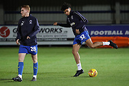 AFC Wimbledon midfielder Tyler Burey (32) and AFC Wimbledon midfielder Alfie Eagan (28) warming up during the EFL Trophy group stage match between AFC Wimbledon and Stevenage at the Cherry Red Records Stadium, Kingston, England on 6 November 2018.