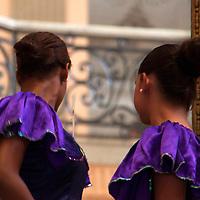 Central America, Cuba, Santa Clara. Cuban ladies in costume for dance performance.
