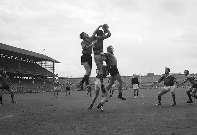 Kerry player catches ball mid air while challenged by two Down players during the All Ireland Senior Gaelic Football Final Kerry v Down in Croke Park on the 22nd September 1968. Down 2-12 Kerry 1-13.