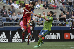 May 26, 2018 - Seattle, Washington, U.S - MLS Soccer 2018: RSL's KYLE BECKERMAN (5) heads the ball away from LAMAR NEAGLE (27) and the RSL goal. Real Salt Lake visited the Seattle Sounders in a MLS match at Century Link Field in Seattle, WA. RSL won the match 1-0. (Credit Image: © Jeff Halstead via ZUMA Wire)
