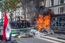 © Licensed to London News Pictures. 21/09/2019. Paris, France. Protesters set fire to scooters in the street and clash with police at climate change demonstration in Paris. Photo credit: Peter Manning/LNP