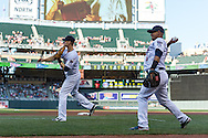 Justin Morneau #33 and Eduardo Escobar #5 of the Minnesota Twins warm up before a game against the Kansas City Royals on June 27, 2013 at Target Field in Minneapolis, Minnesota.  The Twins defeated the Royals 3 to 1.  Photo by Ben Krause