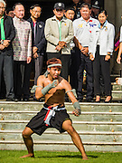 09 JANUARY 2016 - BANGKOK, THAILAND: PRAYUTH CHAN-O-CHA, the Prime Minister of Thailand, (wearing black baseball style hat)  and other Thai government officials watch a martial arts demonstration during Children's Day festivities at Government House. National Children's Day falls on the second Saturday of the year. Thai government agencies sponsor child friendly events and the military usually opens army bases to children, who come to play on tanks and artillery pieces. This year Thai Prime Minister General Prayuth Chan-ocha, hosted several events at Government House, the Prime Minister's office.       PHOTO BY JACK KURTZ