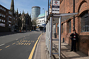 Bus stop in Digbeth in the city centre is virtually deserted under lockdown on 15th April 2020 in Birmingham, England, United Kingdom. Coronavirus or Covid-19 is a new respiratory illness that has not previously been seen in humans. While much or Europe has been placed into lockdown, the UK government has put in place more stringent rules as part of their long term strategy, and in particular social distancing.