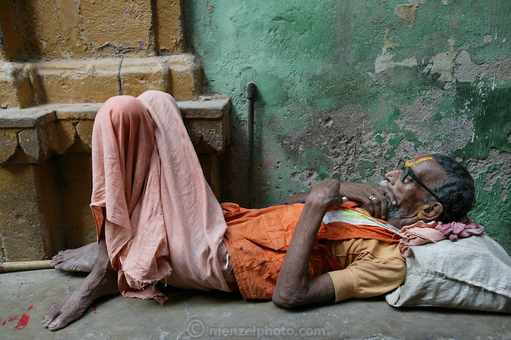 In the narrow streets leading down to the Manikarnika Ghat, in Varanasi, India, many elderly people lounge about, whiling away their time.
