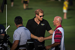 Prince Harry greets a caddy during men's golf at the Invictus Games in Toronto, ON, Canada, on Tuesday, Sept. 26, 2017. Photo by Chris Donovan/CP/ABACAPRESS.COM