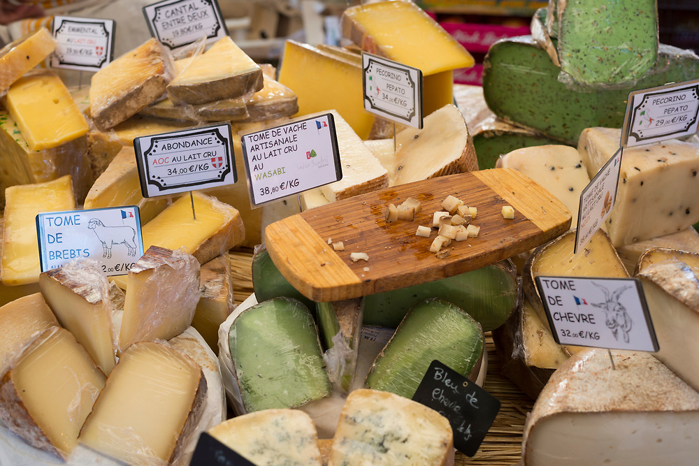 A variety of cheese is displayed for sale at the Saturday market in Aix-en-Provence, France