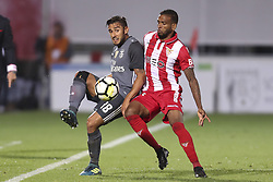 October 22, 2017 - Porto, Aves, Portugal - Benfica's Argentinian forward Toto Salvio (L) with Aves´s players Hamilton (R) during the Premier League 2017/18 match between CD Aves and SL Benfica, at Estadio do Clube Desportivo das Aves in Aves on October 22, 2017. (Credit Image: © Dpi/NurPhoto via ZUMA Press)