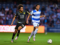 Football - 2021 / 2022 EFL Carabao Cup - Round Two - Queens Park Rangers vs Oxford United - Kyan Prince Foundation Stadium - Tuesday 24th August 2021.<br /> <br /> Chris Willock of Queens Park Rangers shields the ball from Leon Chambers-Parillon of Oxford United.<br /> <br /> COLORSPORT/Ashley Western