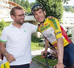 07.07.2017, St. Johann Alpendorf, AUT, Ö-Tour, Österreich Radrundfahrt 2017, 5. Etappe von Kitzbühel nach St. Johann/Alpendorf (212,5 km), im Bild v.l. Georg Totschnig gratuliert tStefan Denifl (AUT, Team Aqua Blue Sport) im gelben Trikot // Georg Totschnif of Austria congratulats Stefan Denifl of Austria (Aqua Blue Sport) in the yellow jersey during the 5th stage from Kitzbuehel to St. Johann/Alpendorf (212,5 km) of 2017 Tour of Austria. St. Johann Alpendorf, Austria on 2017/07/07. EXPA Pictures © 2017, PhotoCredit: EXPA/ Reinhard Eisenbauer