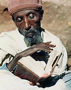 Portrait of an Ethiopian Orthodex Christian reading the Bible in Lalibela, Ethiopia