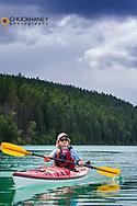 Kayaking on Beaver Lake near Whitefish, Montana, USA model released