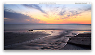 A Blazing Sunset Over Lake Erie At The Mouth Of Crooked Creek, Dunkirk New York, USA