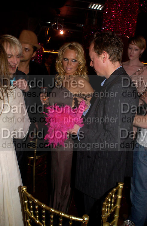 Pamela Anderson and Geordie Greig. Selfridges Las Vegas dinner hosted by  hon Galen , Hillary Weston and Allanah Weston. Selfridges Oxford St. 20 April 2005. ONE TIME USE ONLY - DO NOT ARCHIVE  © Copyright Photograph by Dafydd Jones 66 Stockwell Park Rd. London SW9 0DA Tel 020 7733 0108 www.dafjones.com