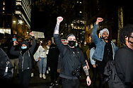 Protesters march and hold up signs at Martin Place during a 'Black Lives Matter' rally on 02 June, 2020 in Sydney, Australia. This event was organised to rally against aboriginal deaths in custody in Australia as well as in unity with protests across the United States following the killing of an unarmed black man George Floyd at the hands of a police officer in Minneapolis, Minnesota. (Photo by Steven Markham/ Speed Media)