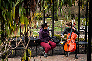 Masked cello teacher Natalie Hagwood teaches Lydia Olaore, of Citrus Heights, her first lesson on the cello outside in McKinley Park in East Sacramento on Tuesday, Jan. 26, 2021. Hagwood says that she has been a cello teacher for six years.
