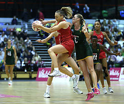 England Vitality Roses' Jade Clarke (left) and South Africa Spar Proteas Erin Burger battle for the ball during the Vitality Netball International Series match at The Copper Box, London.