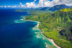 coral reef, Kee Beach, Haena State Park, Haena Beach, Haena Point, and Tunnels Beach in distance, North Shore, Kauai, Hawaii, USA, Pacific Ocean