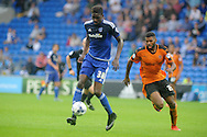 Sammy Ameobi of Cardiff city breaks past Ethan Ebanks-Landell of Wolves ®. Skybet football league championship match, Cardiff city v Wolverhampton Wanderers at the Cardiff city stadium in Cardiff, South Wales on Saturday 22nd August 2015.<br /> pic by Andrew Orchard, Andrew Orchard sports photography.