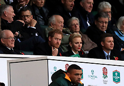 Prince Harry and Charlene, Princess of Monaco in the stands during the Autumn International match at Twickenham Stadium, London.